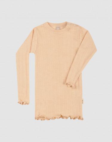 Merino wollen/zijden pointelle top met een subtiele rib en lange mouwen voor baby's.